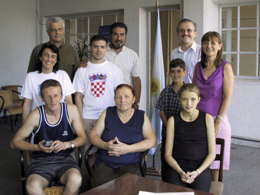 Amela and her family with Sister Gladis Pertara (left), Doctor Horacio Aziz (center back) of the Argentine Transplant Foundation Home, Mr. Natalio Markovic (back right), President of the Croatian Club of Buenos Aires, and other volunteers from the Home and the Croatian Community.