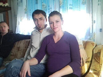 Update: Amela with her husband in 2010, expecting their first child.